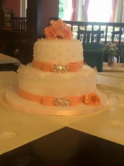 Peach and ivory theme wedding cake!