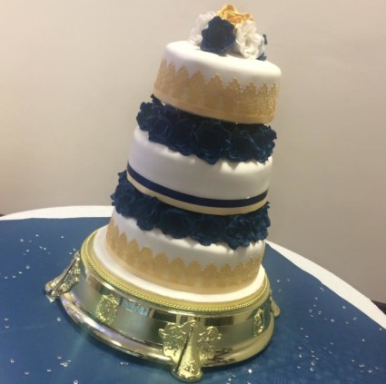 3 tier Wedding Cake on a Bed of Royal Blue Handmade Roses